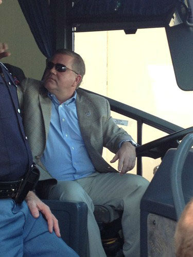 Notre Dame head coach Brian Kelly appears ready to drive the team bus at Fort Lauderdale International Airport, Wed., January 2, 2013. <span class=meta>(Rafer Weigel)</span>